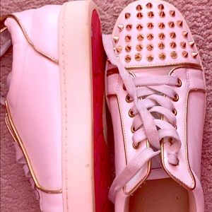 Off white Christian Louboutin with gold spikes